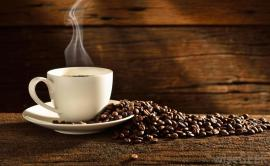 635806393717942917-2045720344_coffee-cup-and-beans-wood-background
